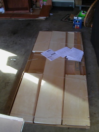 The open box of flat-pack shelving